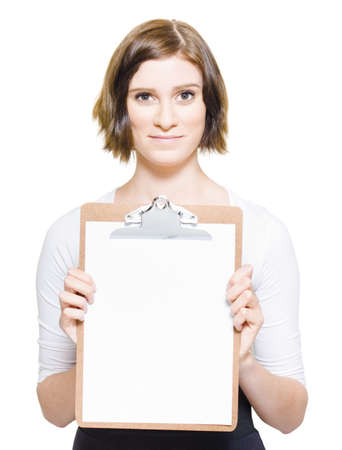 Isolated Studio Portrait Of An Adorable Young Female Business Woman Showing A Blank Copyspace Clipboard In A Place Your Advertising Message Here Concept Stock Photo - 13361079