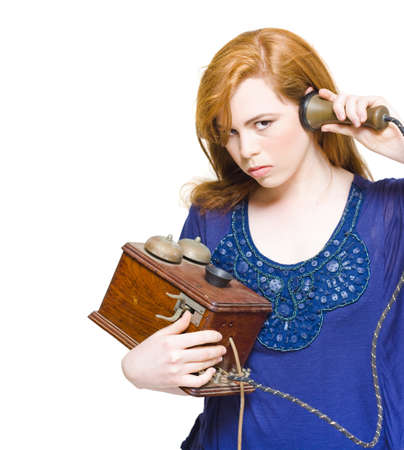 Angry And Enraged Woman Struggling To Establish A Connection To An Operator With A Old Phone In A Miscommunication And Technology Problems Concept, Over White Stock Photo - 13360414