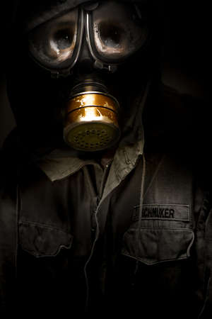 Creative Dark Photograph Of A Dead German Soldier With Rotten Sunken Face Wearing A Faulty Leaking Gasmask In A Casualties Of War Conceptual Stock Photo - 13360018