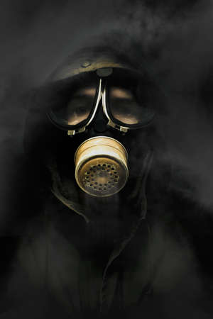 Soldier Standing In The Dead Of Night Breathing Through A Military Issued Gasmask While A Haze Of Toxic Gas And Smoke Circulate Around The Air photo