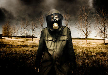 Russian Military Fighter Standing In A Dead Autumn Field As Contaminated Poisonous Air Falls From The Sky During An Attacking Air Raid Bomb photo