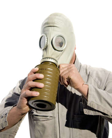 Military Man Puts On A World War 2 Gas Mask For Protection Against Poisonous Gasses Stock Photo - 13382383