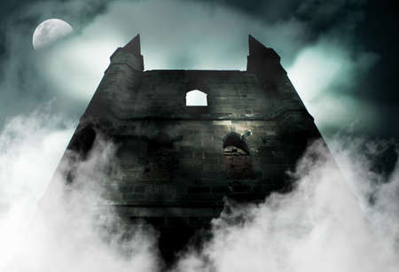 Spooky Is The Chilling Scene During A Horror Full Moon As Mist Rises From The Ruins Of A Old Haunted Castle photo