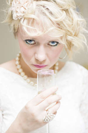 Suspicious and Sinister Looking Woman Holds A Makeup Smeared Wine Glass At A Party While Staring In A Sexy Scary Portrait Of Evil Eyes  photo