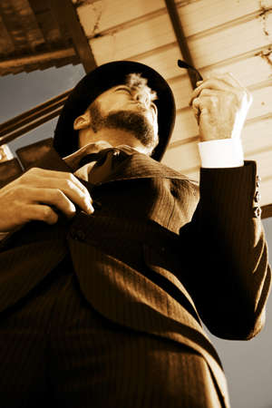 A Well Dressed Vintage Man Puffs Smokes From His Pipe While Distantly Dreaming Away Stock Photo - 13453536