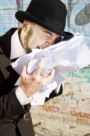 Upset Man Clutching At A Pile Of Scruntch Up Papers Crying Over Paperwork Blues photo