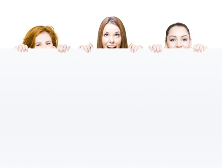 Funny animated photo of a team of surprised business people behind large blank copyspace sign in a cheeky communication of marketing and merchandising on white photo