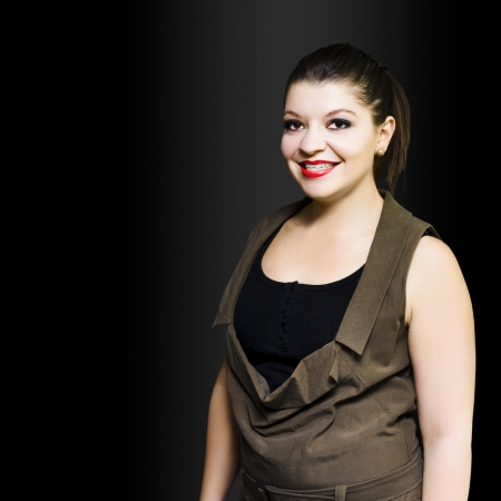 Studio shot of young smiling student with red lipstick on black background with copy space Stock Photo - 14047841