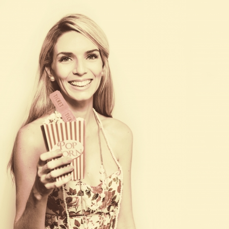 Old Fashioned Portrait Of A Smiling Beautiful Woman Holding A Box Of Popcorn In A Depiction Of Sixties Retro Film, Image With Copyspace Stock Photo - 14047826