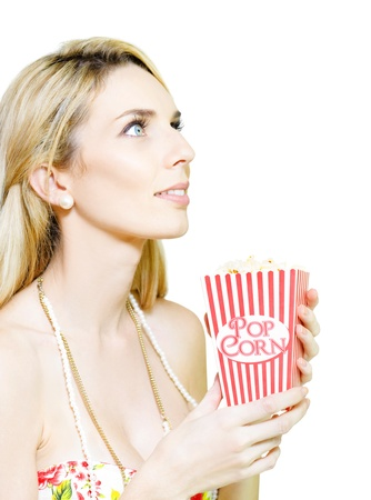 Isolated Studio Portrait Of A Woman Looking Onto Blank Copy Space While Holding A Iconic Striped Popcorn Box In A Film And Movie Concept, White Background Stock Photo - 14041817