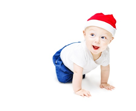 Surprise christmas baby. A cute little christmas baby in a santa hat with an surprised expression crawling on white background Stock Photo - 14053841