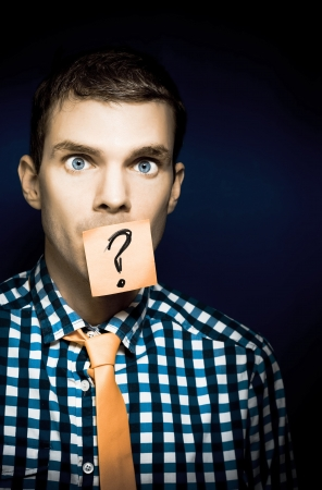 Young Male Business Person In Need Of Help With A Stick Note Question Mark Over His Face Stock Photo - 14080276