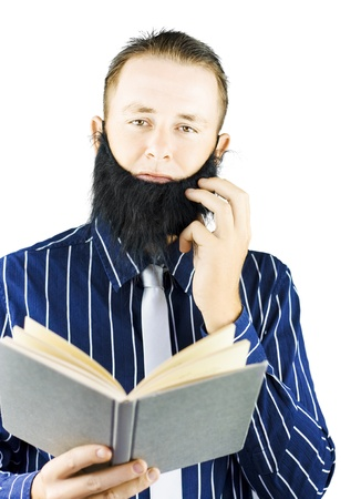 Smart man with beard reading a book of knowledge or religious book, on white background photo
