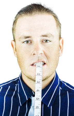 Man biting and holding tape measure in mouth on white background photo