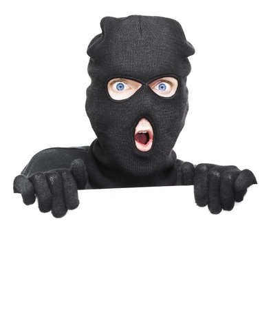 Surprised Robber Caught Holding A Blank White Board During A Break And Enter In A Home Security Copyspace Conceptual, Isolated On White Background photo