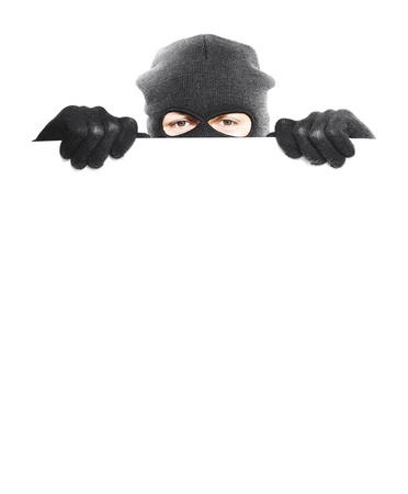 Robber hiding behind a empty white sign with space for text, isolated on white background Stock Photo - 14284405
