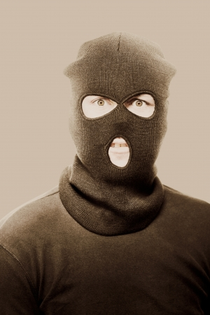 Vintage sepia toned portrait of a radical fanatical terrorist staring with a threatening look of intent to commit acts of violence and terror Stock Photo - 14344105