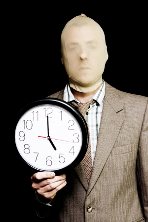 Security Deadline Image Of A Robber Or Burglar Doing Time While Holding Clock At Dusk In A Curfew Depiction Of Night Time Being Prime Time For Crime Time photo