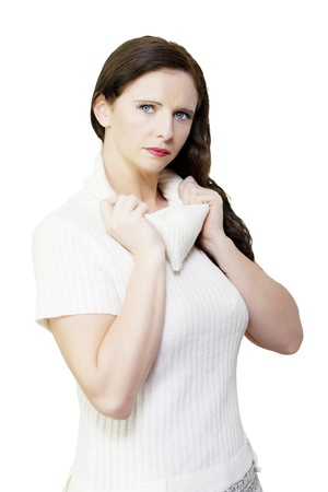 Isolated portrait of beautiful winter woman wearing white fleece jumper on white background photo