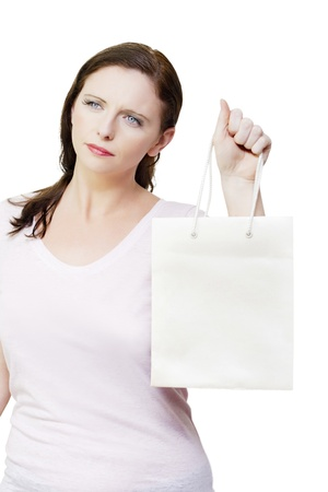 Woman with an idea of retail therapy thinking while holding shopping bags against white background, copyspace on department store bag Stock Photo - 14621778