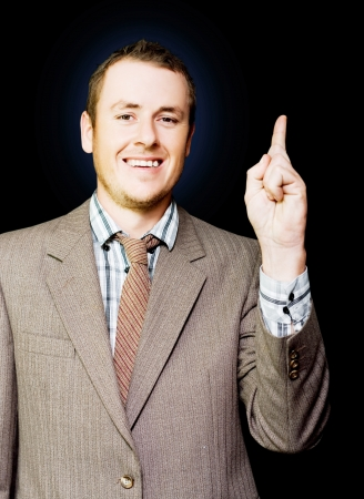 Enthusiastic young business achiever filled with boundless aspirations pointing up Stock Photo - 14632363