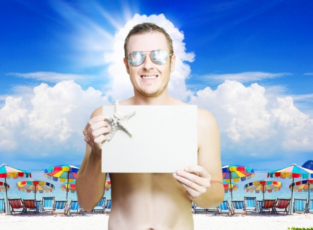 Man holding empty copyspace banner at tropical resort in vacation paradise , photo taken Phi Phi Island Thailand Stock Photo - 14680104