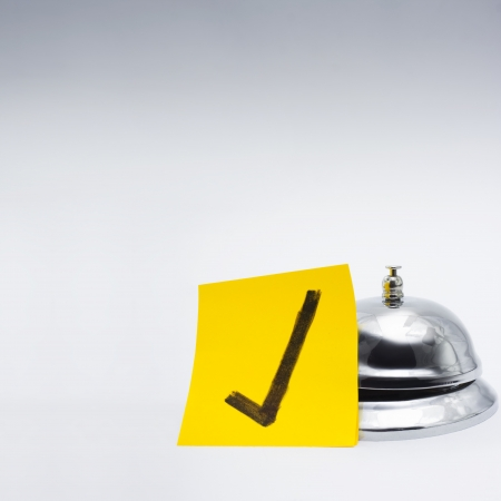 Retail service bell accompanied by a gold class approval tick in a depiction of good customer service photo