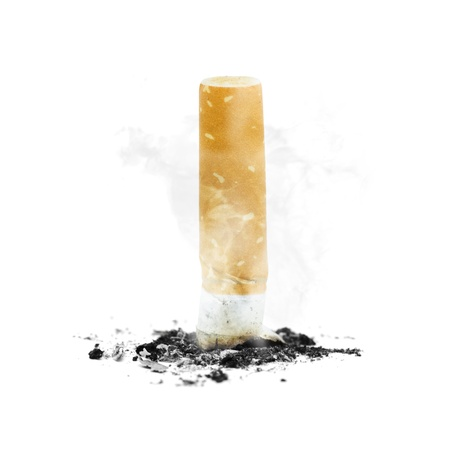 Quit smoking concept with a cigarette butt stubbed out amidst ash and smoke on white background photo