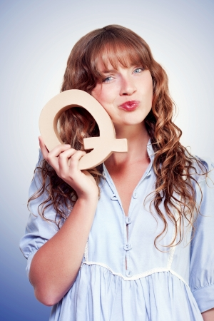 Young woman student with a question standing with a uncertain look holding up a large capital Q Stock Photo - 14796365