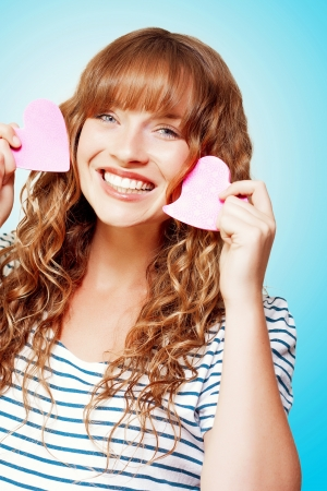 Beautiful Smiling Young Woman Holding Two Love Heart Note Pads In A Romantic Depiction Of Sending A Love Letter Stock Photo - 14796391