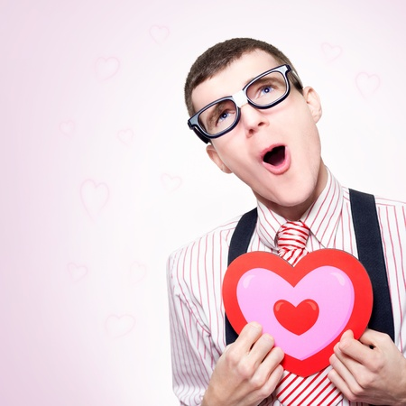 Funny Portrait Of A Romantic Nerd Dreaming Of A Long Lost Love His Dorky Heart Still Aches For, On Pink Heart Shaped Background photo