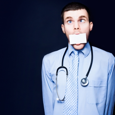 Crazy Cross Eyed Pediatrician Doctor Handing Over His Business Credentials Via Lip Service And Word Of Mouth While Displaying A Case Of Foot In Mouth Disease Stock Photo - 15260912