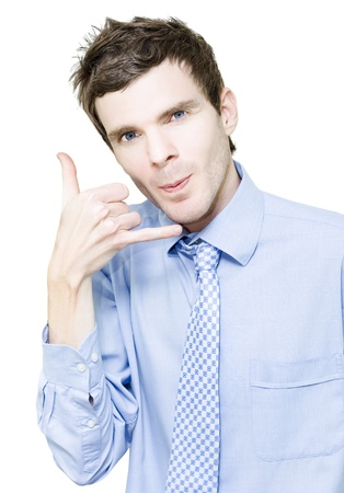 Isolated Young Male Businessman Gesturing Phone With Hand While At A Call Centre On White Background photo