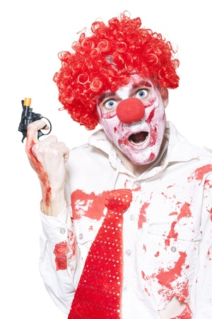Evil Clown In Blood Stained Business Outfit Holding Cap Gun During A Halloween Robbery On White Background Stock Photo - 15431807