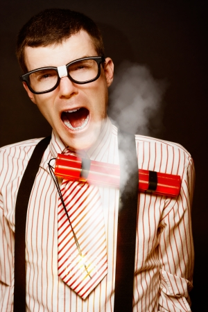 Vintage Businessman Dork With A Bomb Tucked Under Suspenders In A Explosive Stress Conceptual On Black Background Stock Photo - 15482419