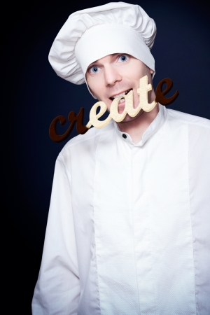 Dessert Chief Eating The Word Create Covered In Chocolate In A Depiction Of Eat Creative Cooking On Dark Studio Background Stock Photo - 15629706