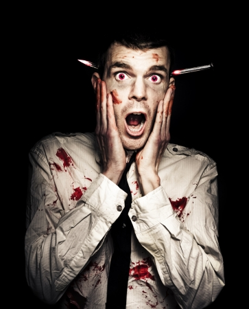 Frightened Zombie Business Man Displaying A Expression Of Terror In A Shock Horror Concept On Black Background photo