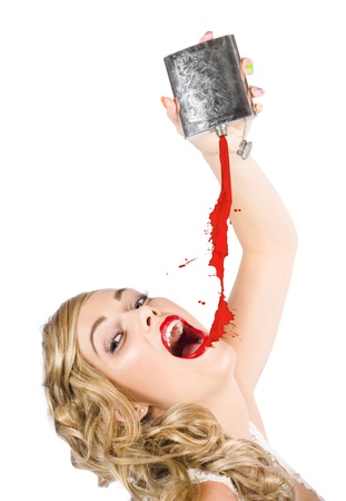 Beautiful Blonde Female Make-up Artist Pouring Liquid Lipstick On Lips With A Hip Flask In A Depiction Of Creative Makeup Over White photo