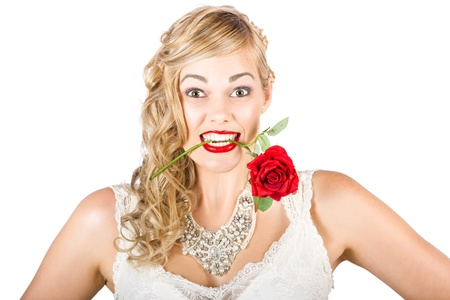 Excited Woman Holding Rose In Mouth During A Valentines Day Romance On White Background photo