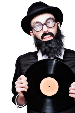 Humorous Portrait Of A Sixties Retro Rock Man With Beard Moustache And Glasses Holding Music Record Vinyl In A Depiction Of 60s Rock N Roll Music photo