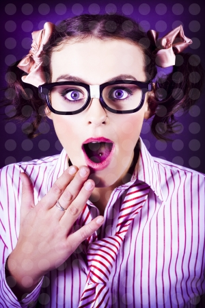 Purple Toned Image Of A Excited Young Business Woman With Hand To Mouth Look Of Surprise In A Depiction Of Comic Relief photo