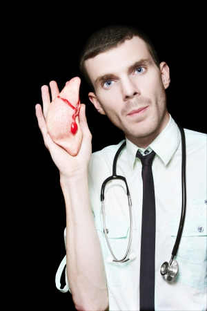 Serious Male Medical Doctor Holding Display Heart During A Cardiology Education Seminar Stock Photo - 16008816
