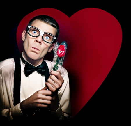 Romantic Valentines Day Nerd Holding Rose On Love Heart Background photo