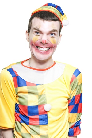 Funny Looking Joker In Clown Costume Laughing And Telling Jokes At A Childrens Birthday Party Celebration In A Depiction Of Comedy Entertainment Over White  Stock Photo - 16008814
