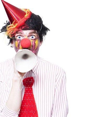 Humorous Birthday Clown Making Invitation To Guests Through Party Hat Over White Background Stock Photo - 16008807