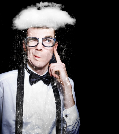 Intelligent Thinking Man Deciding Weather Or Not While A Cloud Of Rain Hovers Above Head In A Depiction Of Brainstorming Over Black Background photo