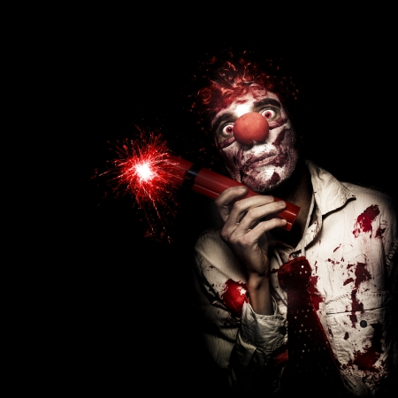 Creepy Business Person In Bloody Clown Suit Holding Stick Of Lit Dynamite On Black Studio Background Stock Photo - 16128128