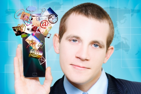 Businessman Streaming Digital Media Apps Through A Smartphone In A Global Connect Concept Stock Photo - 16405245