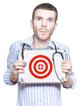 Doctor With Target Symbol On First Aid Kit In A Medical Donation Concept Of Targeting A Cure photo