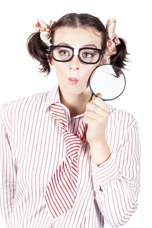 Studio Photograph Of A Business Women Seeking A Solution With Magnifying Glass photo
